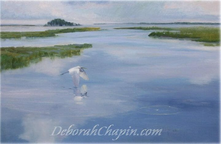 "Touching the Clouds, The Egret flying over the water just skims the mirror of the sky creating concentric rings rippling through the water. ""I painted this piece on location as a series of wetland pieces to decide the perfect location and the perfect time to paint with the water mirroring the sky. This piece shows the harmony between the wildlife and the environment."""