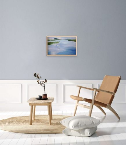 This Landscape painting, Touching the Clouds, is a 16x24 original oil painting on stretched linen canvas. The Egret flying over the water just skims the mirror of the sky creating concentric rings rippling through the water.